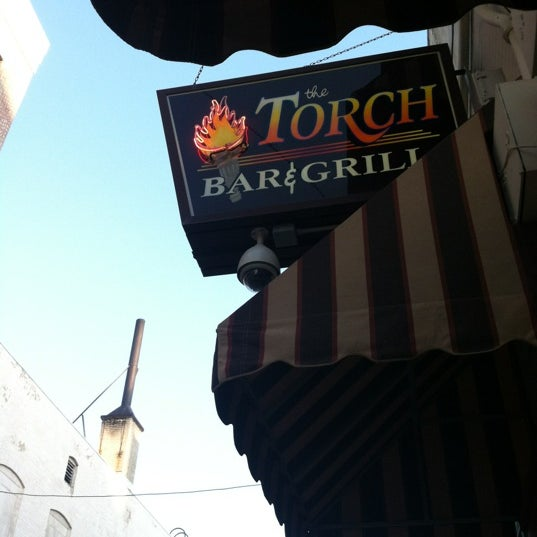 Photo taken at The Torch Bar and Grill by Katie C. on 3/17/2012