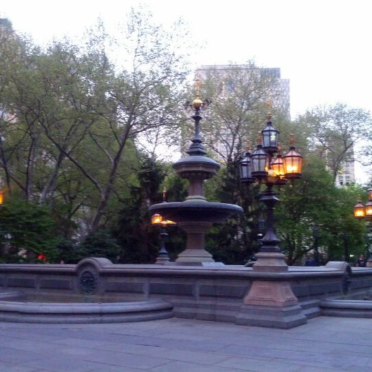 Photo taken at City Hall Park by Kim B. on 4/15/2012