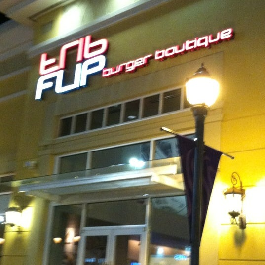 Photo taken at FLIP Burger Boutique by Barry R. on 3/17/2012