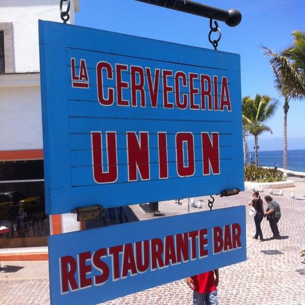 Photo taken at La Cerveceria Union by Sergio J. on 5/7/2013