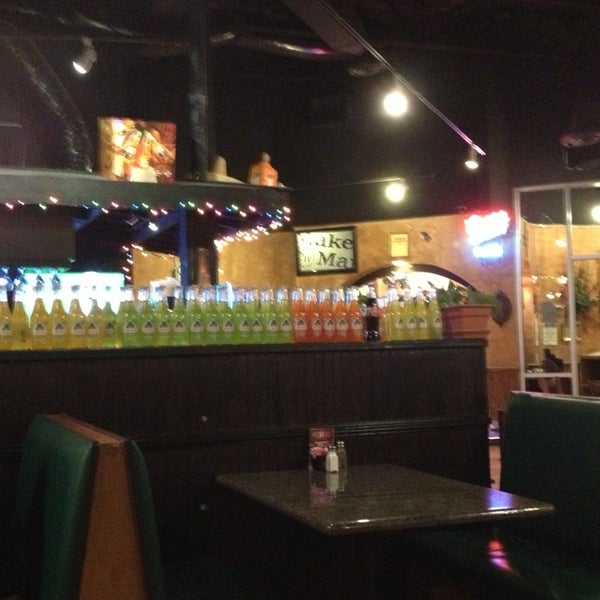 Photo taken at Mexi-Go Restaurant by Susan P. on 12/23/2012