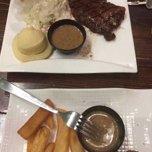 Photo taken at Melantak Steak Hub by Nazratul A. on 10/2/2016