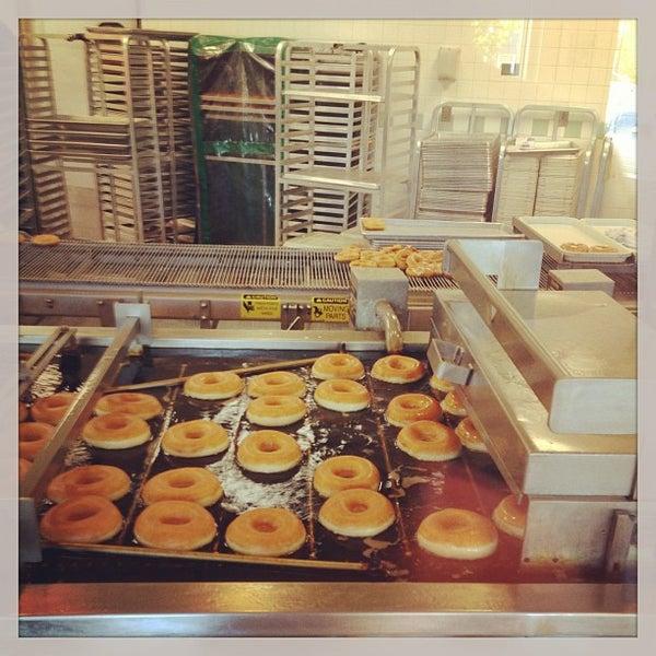 Photo taken at Krispy Kreme Doughnuts by Mike A. on 4/23/2013