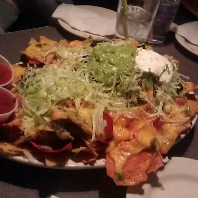 Photo taken at Sunset Cantina by Stefanie on 9/30/2012
