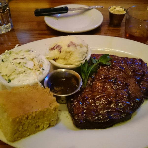 Photo taken at Weber Grill Restaurant by Greg M. on 11/17/2014