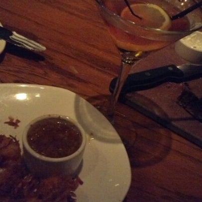 Photo taken at Outback Steakhouse by Metro O. on 11/18/2012