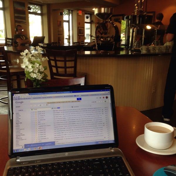 Photo taken at Arcedium Coffeehouse Inc by Nick P. on 6/22/2015