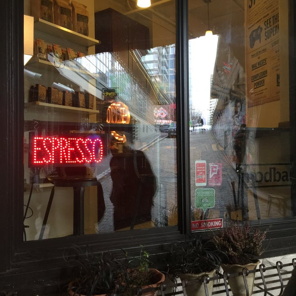 Photo taken at Ghost Alley Espresso by Athan R. on 2/6/2016