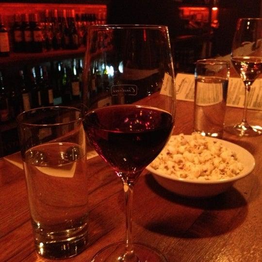 Photo taken at Custom Wine Bar by sharilyn on 12/14/2012