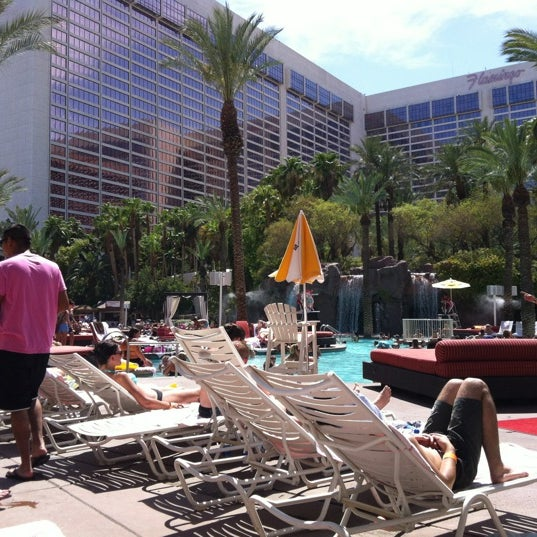 Photo taken at Flamingo GO Pool by JINJIN on 7/18/2012