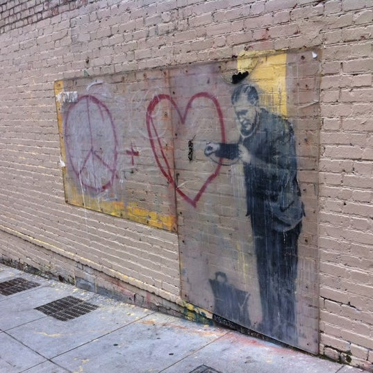 Banksy mural 39 peaceful hearts 39 doctor ferm maintenant for Banksy mural painted over