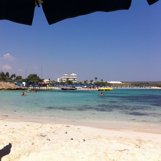 Go behind the Watersports. There is a very quiet and small beach with beautiful water.