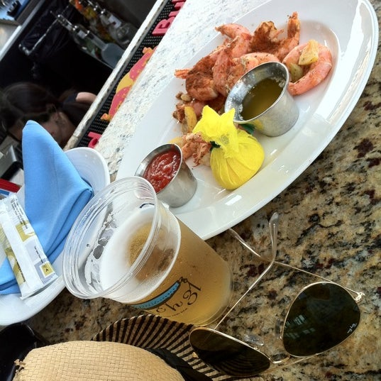 Steamed shrimp and a cold beer on the outdoor patio bar! That is Summer!