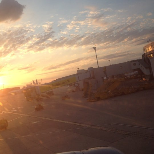 Photo taken at Gate C38 by Christian K. on 6/23/2012