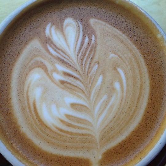 Photo taken at Stumptown Coffee Roasters by Melanie T. on 4/2/2012