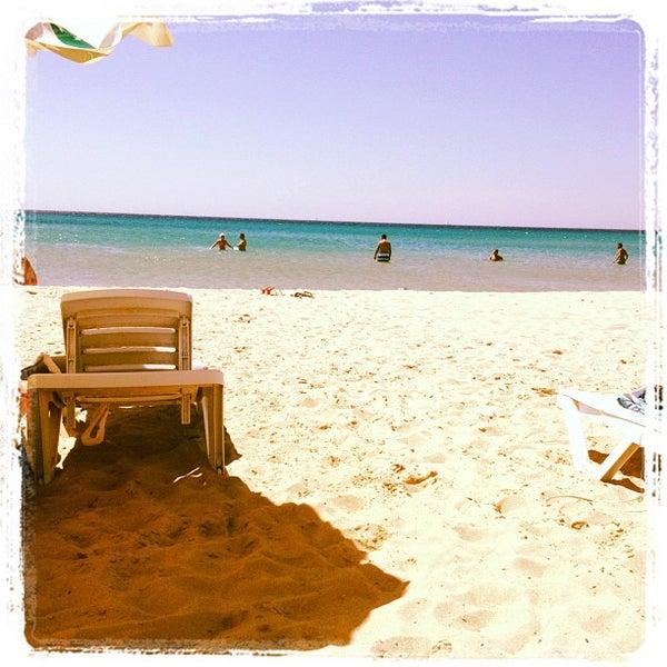 Photo taken at Ramo Beach by Taner E.I. on 8/18/2012