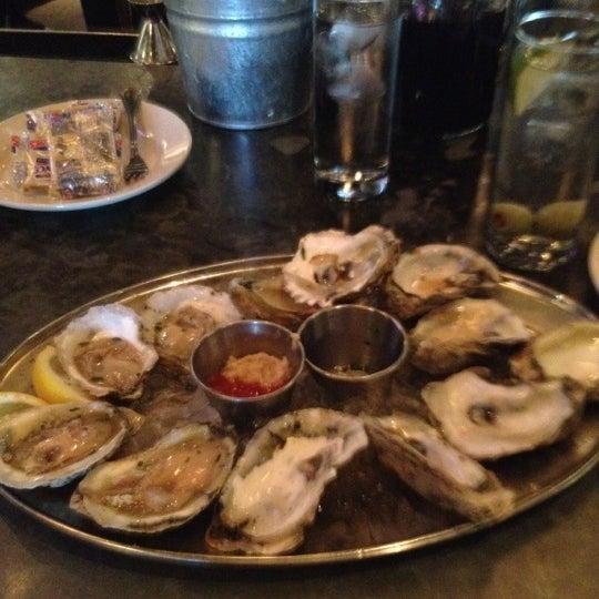 Photo taken at Doc Crow's Southern Smokehouse & Raw Bar by Jason H. on 6/27/2012