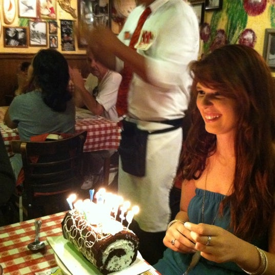 Photo taken at Buca di Beppo by Kristen S. on 8/1/2012
