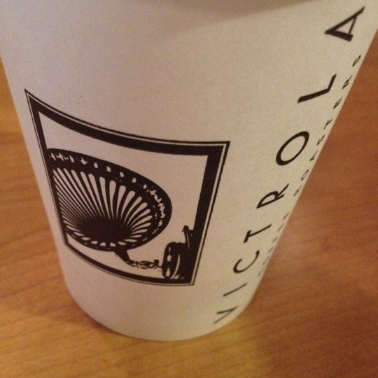 Photo taken at Victrola Cafe and Roastery by feistyfeaster on 2/14/2012