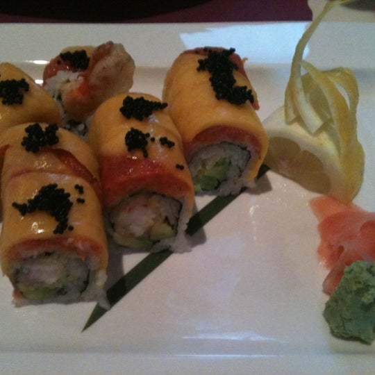 Photo taken at Sushi Cafe by Michele O. on 8/16/2011