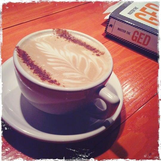 Photo taken at Bennu Coffee by Melissa F. on 3/29/2011