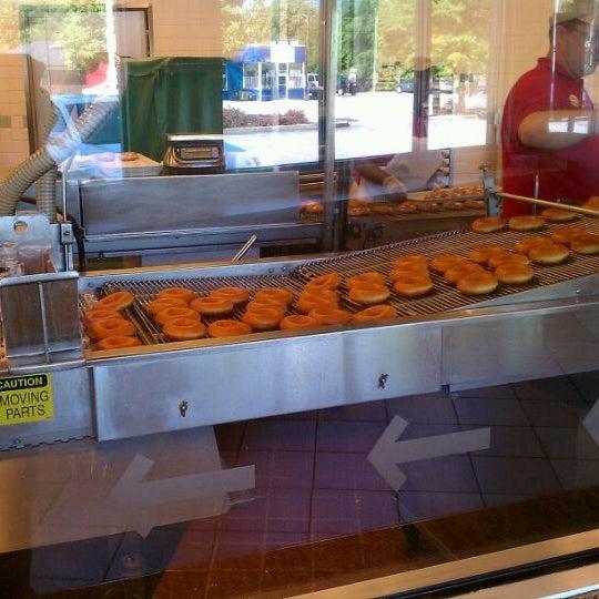 Photo taken at Krispy Kreme Doughnuts by Hadrian X. on 4/11/2012