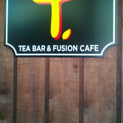 Photo taken at T. Tea Bar & Fusion Cafe by alison on 6/30/2012