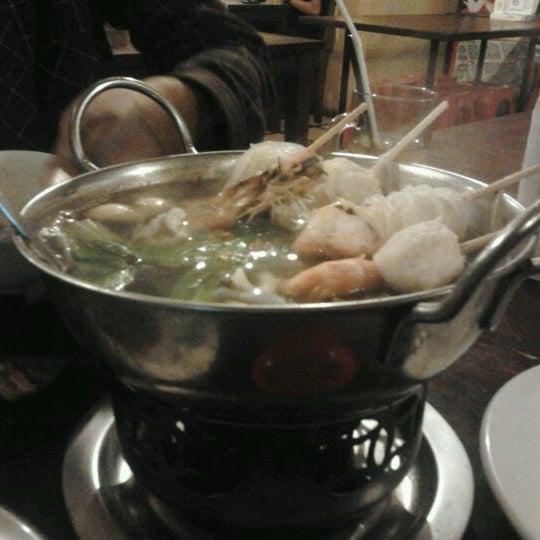 Photo taken at Phuket Thai Resto by Nita S. on 4/6/2012