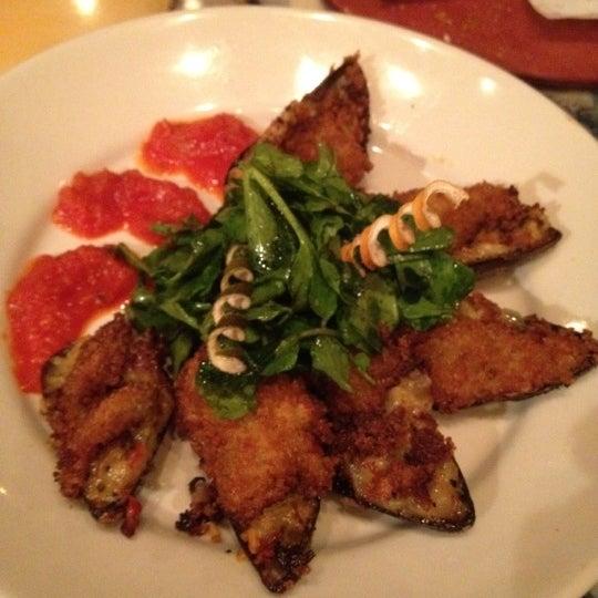 Photo taken at Café Tu Tu Tango by Gina M. on 7/26/2012