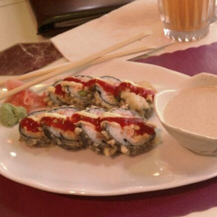 Photo taken at Sushi Cafe by Catherine R. on 11/18/2011