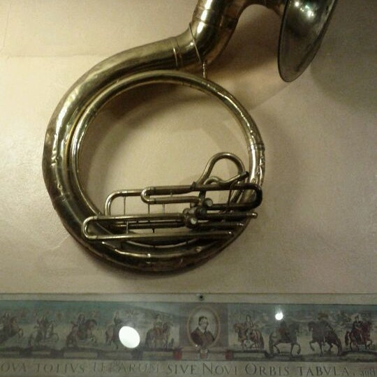 Photo taken at Travelers Club International Restaurant and Tuba Museum by Ren R. on 1/10/2012