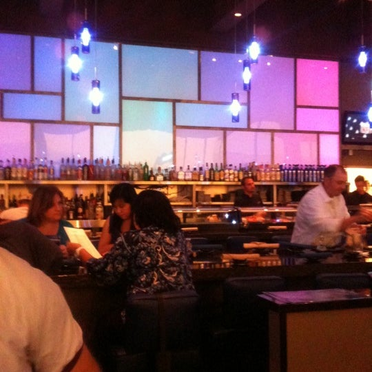 Photo taken at Blue Wasabi Sushi & Martini Bar by Alison M. on 8/19/2011