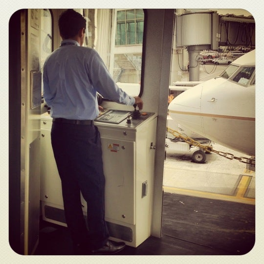 Photo taken at Gate 5 Aeropuerto Internacional Juan Santamaria by Edwin Vargas R. on 5/4/2012