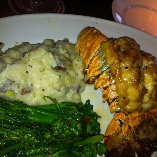 Photo taken at Pappadeaux Seafood Kitchen by Marc S. on 7/2/2012