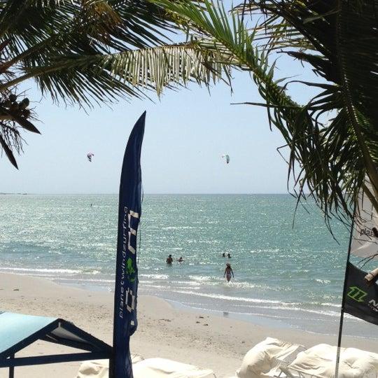 Photo taken at Playa El Yaque by Jose D. on 3/31/2012