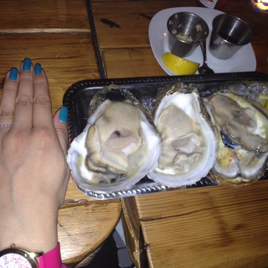 Photo taken at Upstate Craft Beer and Oyster Bar by Dana D. on 2/11/2012