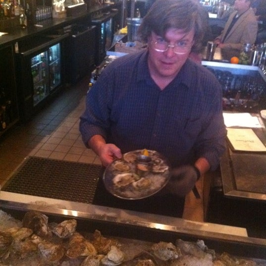 Photo taken at Doc Crow's Southern Smokehouse & Raw Bar by Mark P. on 5/16/2011