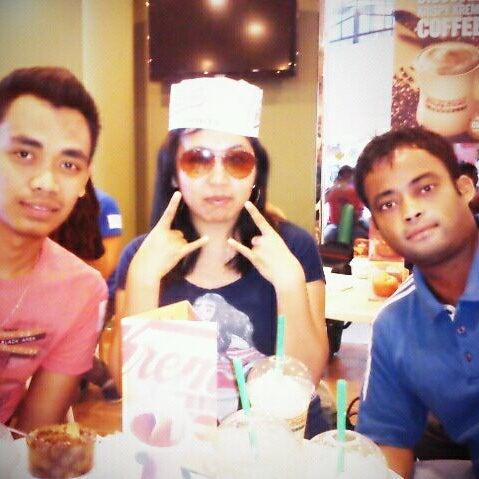 Photo taken at Krispy Kreme by Agnes J. on 10/25/2011
