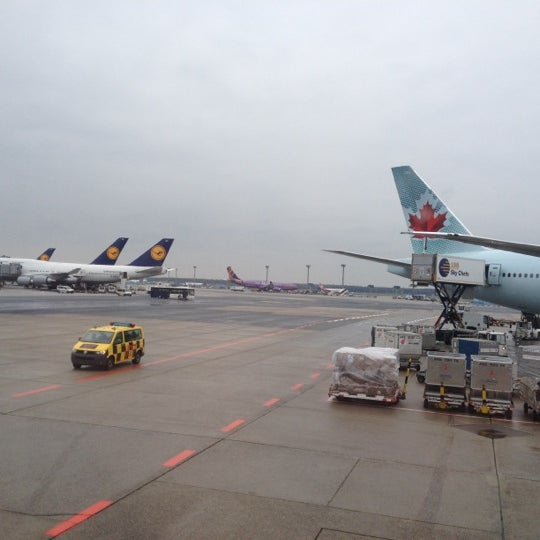Photo taken at Gate A25 by Pavel N. on 4/9/2012