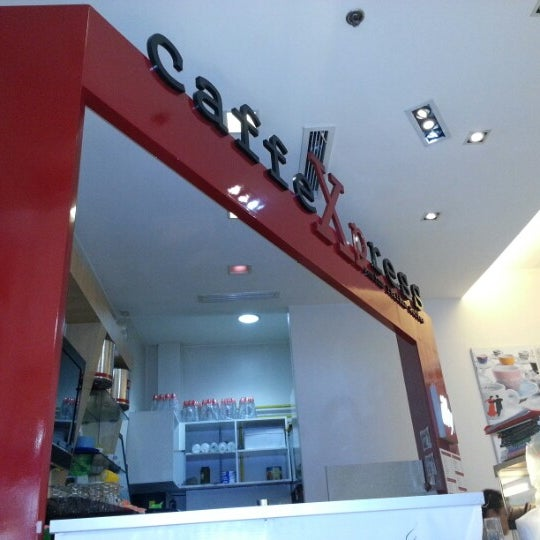Photo taken at CaffeXpress by Crisian C. on 9/13/2012
