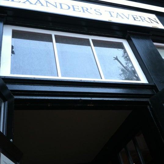 Photo taken at Alexander's Tavern by Tara F. on 7/26/2011