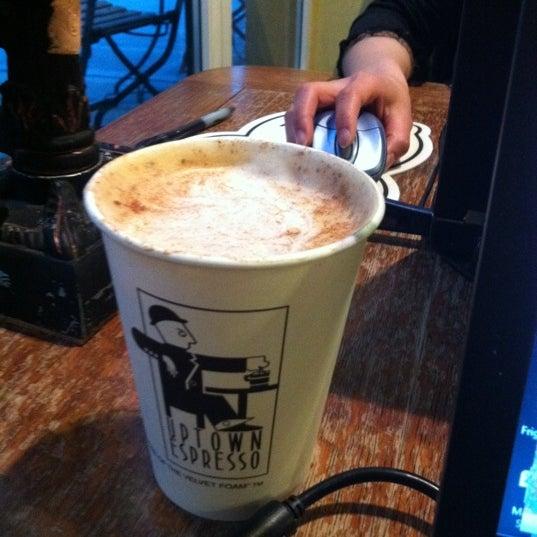 Photo taken at Uptown Espresso by John N. on 5/30/2011