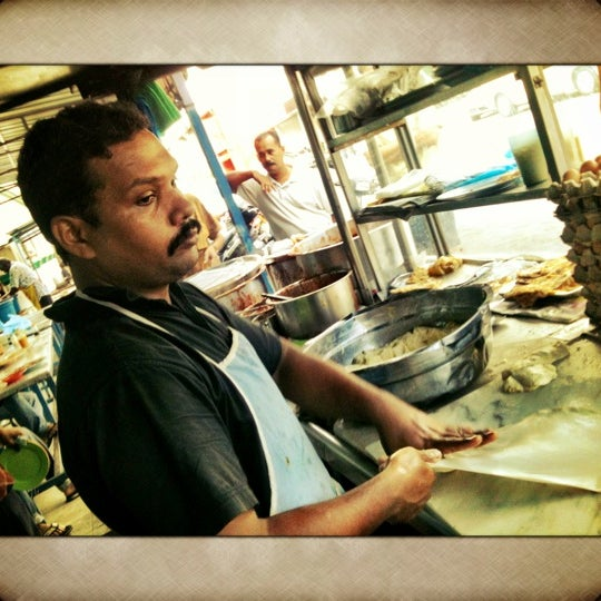 Photo taken at Roti Canai Transfer Rd. by Dave R. on 4/15/2012