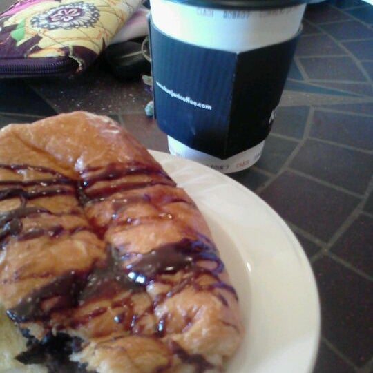 Photo taken at Kunjani Coffea by Jessica C. on 2/18/2012