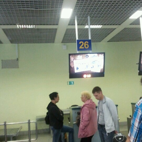 Photo taken at Check-in desk by Alexander L. on 6/16/2012