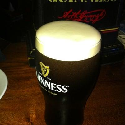 Photo taken at Fado Irish Pub & Restaurant by Joe S. on 8/7/2012