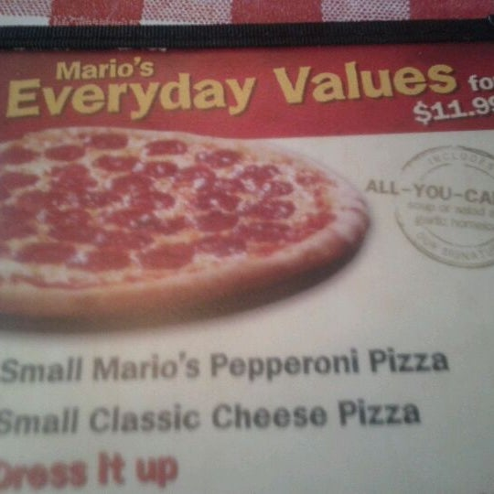 Photo taken at East Side Mario's by Paul B. on 12/3/2011