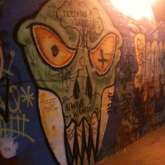 Photo taken at Krog Street Tunnel by Katie M. on 4/15/2012