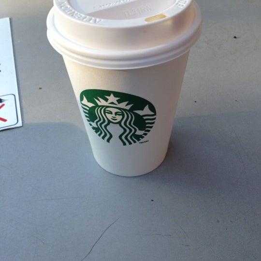 Photo taken at Starbucks by Erin C. on 8/23/2012