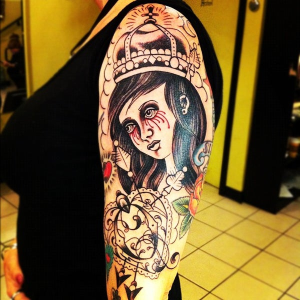 Photo taken at Let It Bleed Tattoo by r v. on 11/22/2011